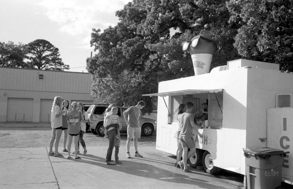 People gather outside Sno Beach to indulge in a sno cone